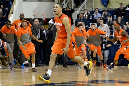 Tyler Ennis Syracuse's Tyler Ennis celebrates after scoring the game-winning shot against Pitt at the Petersen Events Center.