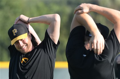 grilli0216 Pirates closer Jason Grilli, left, stretches out his pitching arm at spring training.