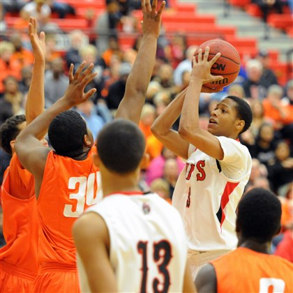 20140207JHZsportsBB01.jpg Aliquippa's Shaunqueze Adamson shoots over Beaver Falls defenders during a game last Friday.
