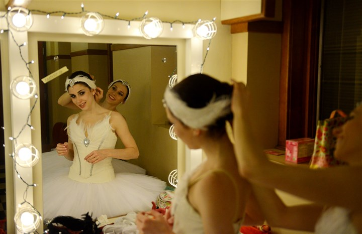 20140212MWHballetLocal02-1 Pittsburgh Ballet Theater dancers Gabrielle Thurlow, right, and Caitlin Peabody, prepare for a dress rehearsal of Swan Lake at the Benedum Center in Downtown Pittsburgh on Wednesday, Feb. 12, 2014.