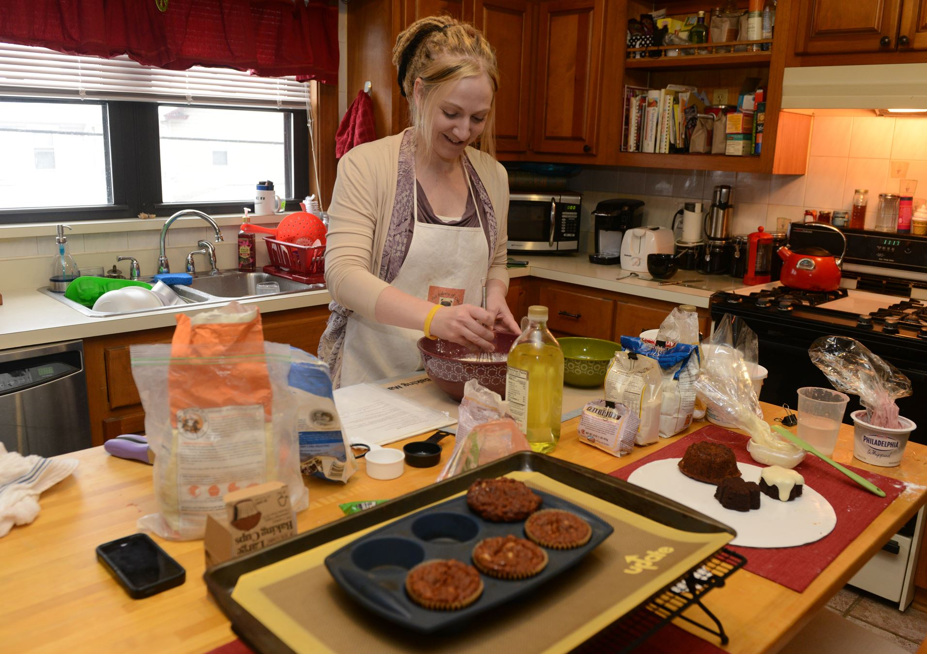 Lavery Veterinarian Sara Lavery makes a batch of chicken parmesan pretzel dog treats in her Oakmont Kitchen.