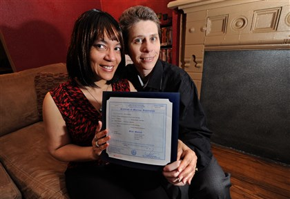 20140211JHLocalGayWed01 The McKees Rocks couple hold their New York City marriage license issued June 22, 2012, the day they were married in New York, where same-sex marriage is legal.