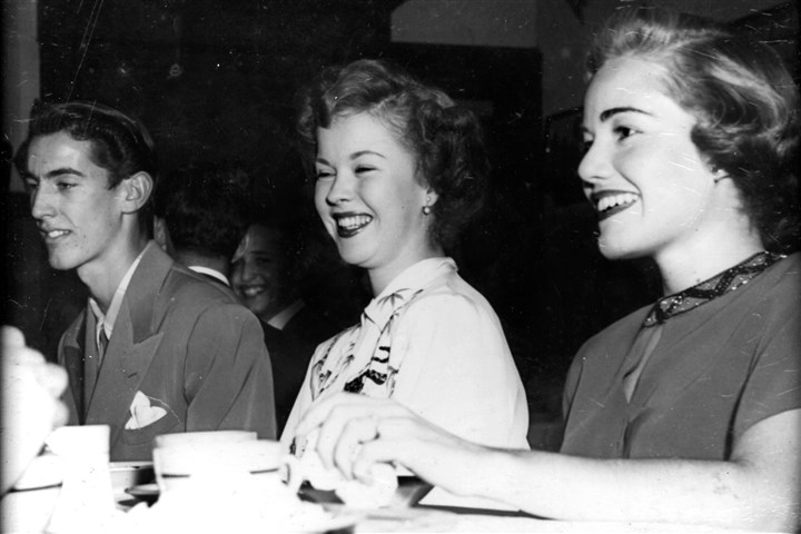 "Sigma Alpha Epsilon The fraternity brothers of Sigma Alpha Epsilon were surprised when Shirley Temple accepted their lunch invitation in the fall of 1948 while filming ""Mr. Belvedere Goes to College"" on the University of Nevada's Reno campus. From left: student Bill Jager, Shirley Temple and her unknown stand-in."