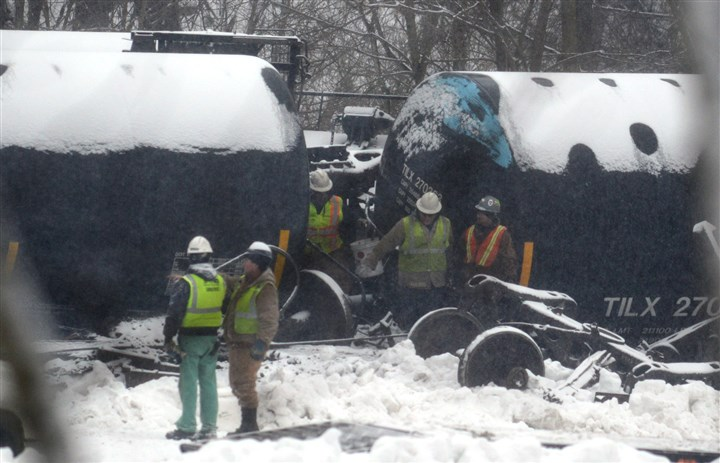 Railroad accident Investigators cross between two overturned railcars Thursday in Vandergrift.