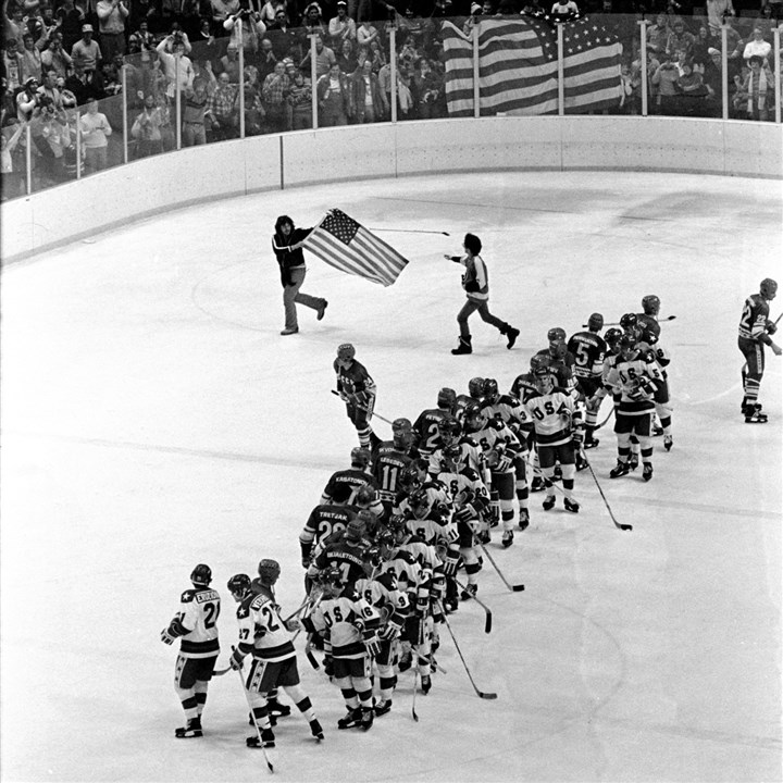 Miracle on Ice A fan runs across the ice carrying an American flag as the U.S. hockey team, white jerseys, and the Soviet team, shake hands after the U.S. won, 4-3, in a Feb. 22, 1980 Olympic hockey game.