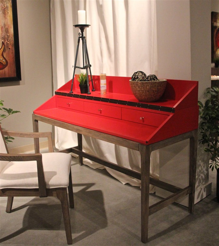 lasvegas6-7 This Somerton Dwelling desk in poppy red can convert to a flat top.