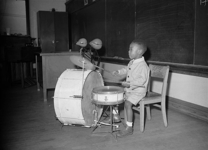 "20140204THTeenie12735mag.1 Roger Humphries was 4 1/2 when he posed for this Charles ""Teenie"" Harris photo with his first drum set in an elementary school music room on the North Side."