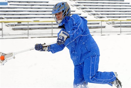 West Virginia snow Brandon Ralston, a junior at Fairmont Senior High School, takes advantage of a snow day yesterday in East-West Stadium in Fairmont, W.Va.
