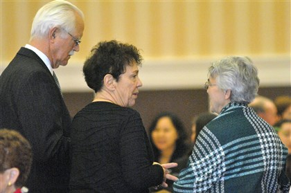 Wolfe sisters funeral 01 Jack and Pierrette Wolfe talk to an attendee at a funeral luncheon Friday in Clinton, Iowa, for their daughters, Susan and Sarah, who were shot to death at their East Liberty home on Feb. 7.