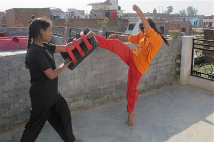India self-defense Members of Red Brigade, a neighborhood group of young women who advocate self-defense training to combat the problem of rising rapes, practice in Lucknow, India.