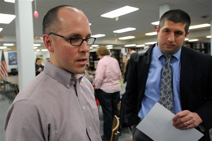 Jarrod McCowin, president of Blackhawk teachers union Jarrod McCowin, left, senior English teacher and president of the Blackhawk teachers union, and Kelly Compeau, from the Pennsylvania State Education Association, speak to reporters after the public meeting of the Blackhawk school board in a public meeting at Blackhawk High School in Beaver County.