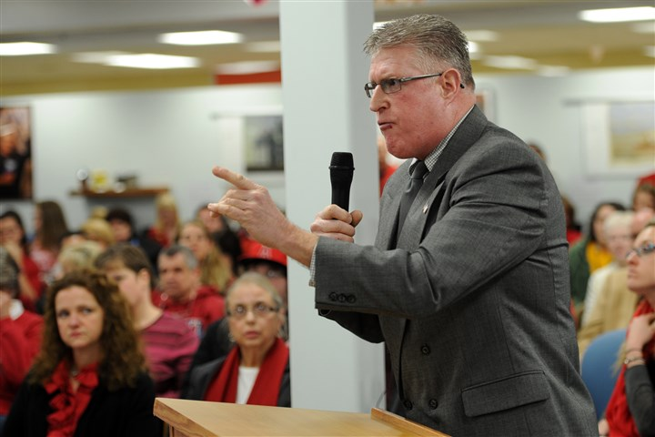 Clint Berchtold, resident of Blackhawk school district Clint Berchtold, resident of the school district with children in school, admonishes the Blackhawk school board for overturning the early bird contract approval at a public session of the board meeting at Blackhawk High School in Beaver County on Friday.