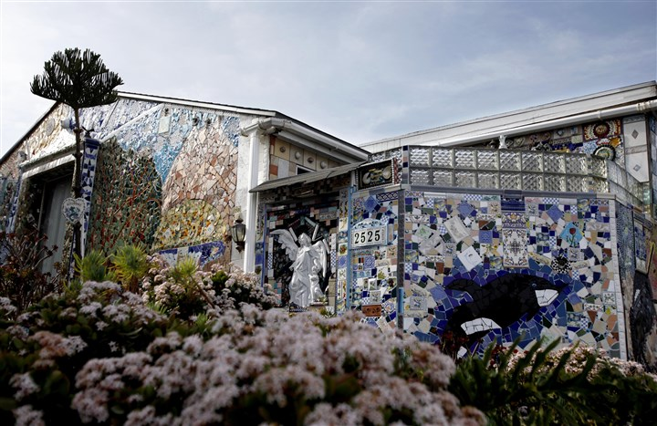 Tilehousethree-3 Louise and Aziz Farnam have spent the past dozen years or so applying various tiles, plates and glass to their home in Santa Monica. They have finally finished the exterior of the home. ()