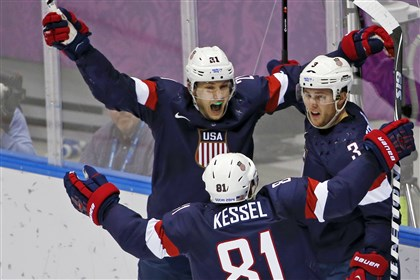 Sochi Olympics Ice Hockey Men U.S. forward James van Riemsdyk, defenseman Cam Fowler and forward Phil Kessel celebrate a goal by Fowler against Russia on Saturday.