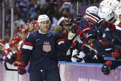 Sochi Olympics Ice Hockey Men U.S. forward T.J. Oshie is greeted by teammates after scoring a goal during a shootout against Russia in overtime Saturday.