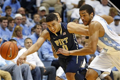 Pittsburgh N Carolina Basketball North Carolina's James Michael McAdoo battles with Pitt's James Robinson during the first half in Chapel Hill, N.C., Saturday.