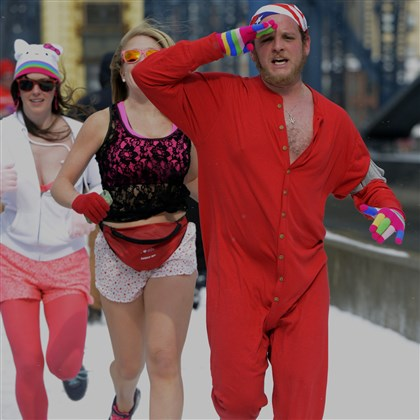 Undie Run 3 Brad Zacchero of Baltimore runs in Pittsburgh's first Cupid's Undie Run Saturday to raise money for the Children's Tumor Foundation and to raise awareness of neurofibromatosis.