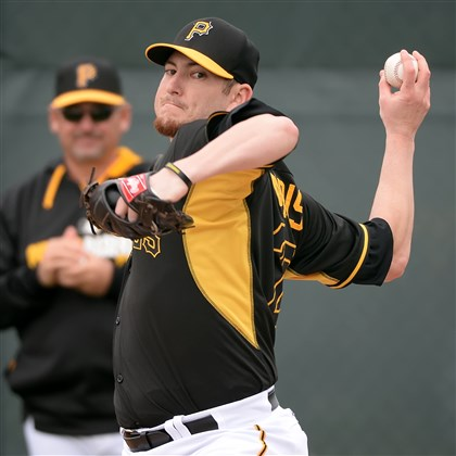 bryanmorris0602 The Pirates acquired the 39th pick in the 2014 draft from the Miami Marlins in exchange for pitcher Bryan Morris, seen here delivering a pitch in a bullpen session March 15 at Pirate City in Bradenton, Fla.