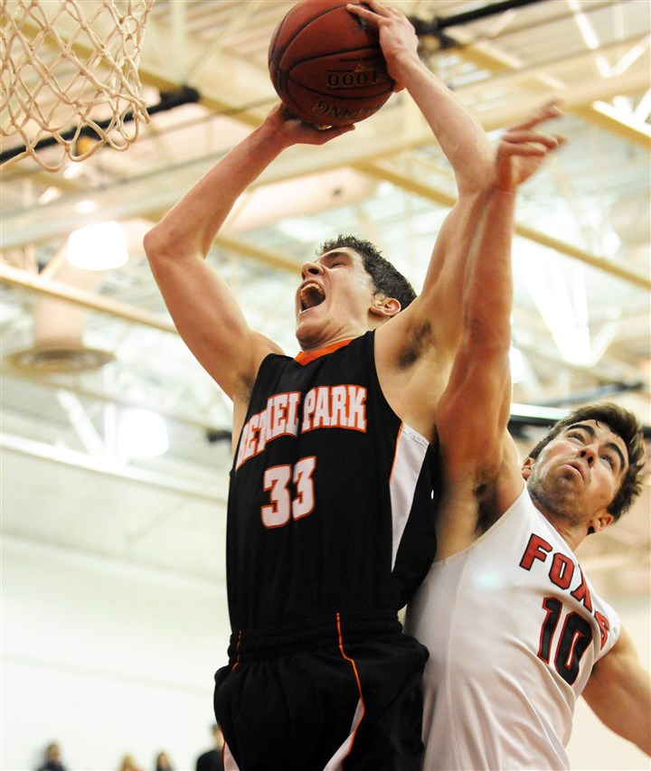 hsgame3 Bethel Park forward Joshua Krafczynski reaches for the basket against Fox Chapel's Connor Duquette in Boys Class AAAA action at North Hills.