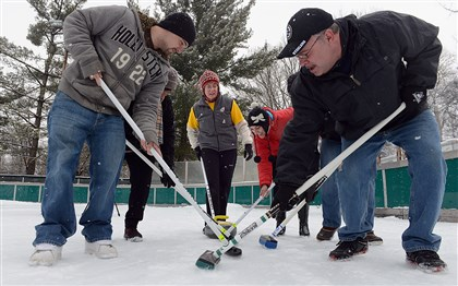Curling As she pushes a stone forward, Marie Rose, center, gives sweeping instructions Sunday to beginners at the curling workshop held by the Pittsburgh Curling Club for about 400 people at Schenley Park's ice rink. Sweeping controls the direction and speed of the moving stone.