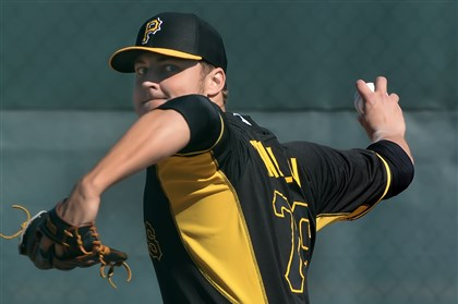 Jameson Taillon delivers  Jameson Taillon delivers during bullpen session at Pirate City, in Bradenton, Fla., last month.