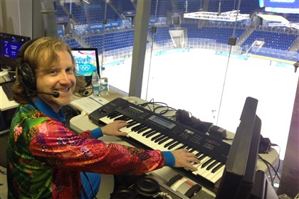 organist0217 Dieter Ruehle, an American, plays the organ during Olympic hockey games at Shayba Arena in Sochi, Russia.