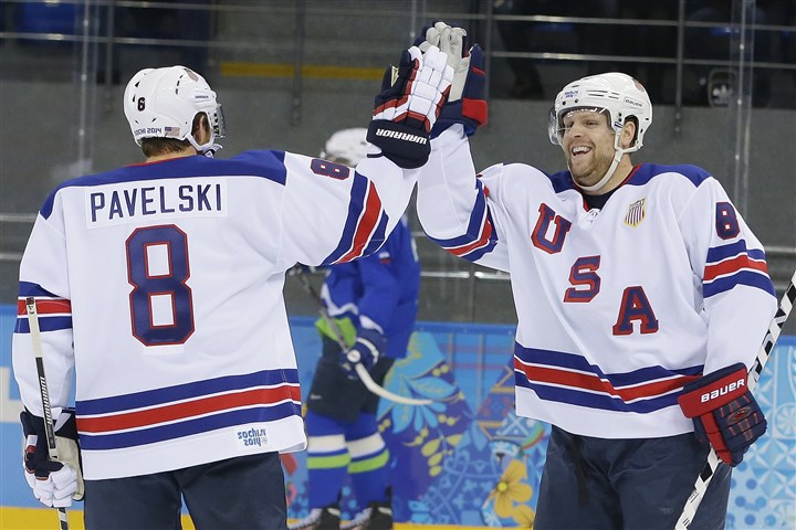 Sochi Olympics Ice Hockey Men USA forward Phil Kessel, right, celebrates his second goal with teammate Joe Pavelski during the 2014 Winter Olympics men's ice hockey game against Slovenia at Shayba Arena Sunday in Sochi, Russia.