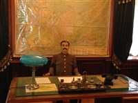 A life-size wax statue of Josef Stalin sits behind a desk in his office in the dacha.