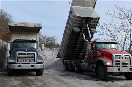 20140217dsSaltLoc03-1 Trucks make their deliveries of rock salt to the city of Pittsburgh Dept. of Public Works 3rd Division in Hazelwood, the last rock salt to be delivered before the snow arrived Monday evening.