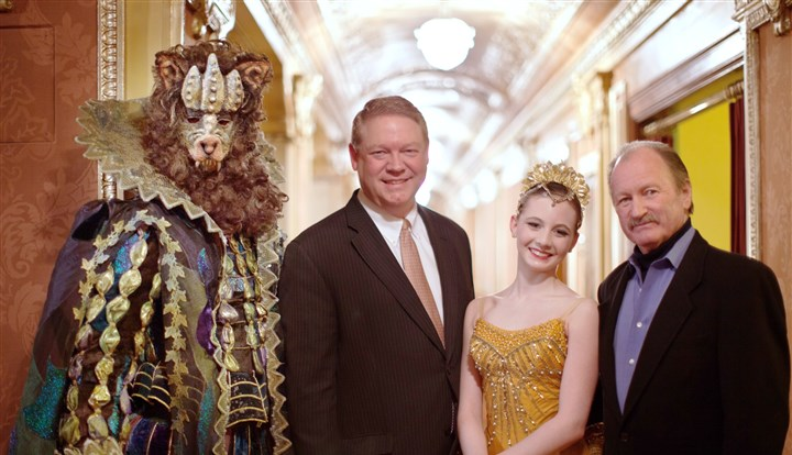 20140217hoPBT4mag H. Scott Cunningham, center, and Artistic Director Terrence Orr with characters from Beauty and the Beast.