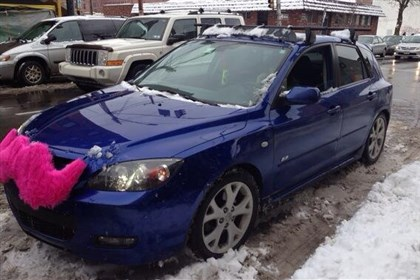 Lyft photo by Alexandra Oliver This Mazda in Pittsburgh is outfitted with Lyft's signature pink mustache.