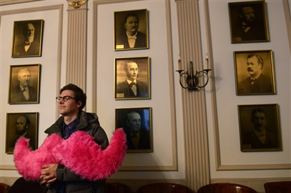 Will Farino, Lyft Will Farino, part of the launch team for Lyft in Pittsburgh, listens to Mayor Peduto during a news conference Tuesday where he expressed his support for competition in the public transportation market.