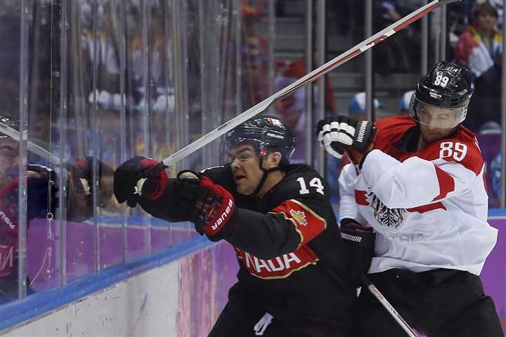 Canada's Chris Kunitz in Olympics Austria forward Raphael Herburger checks Canada forward Chris Kunitz in the second period of a men's ice hockey game at the 2014 Winter Olympic.