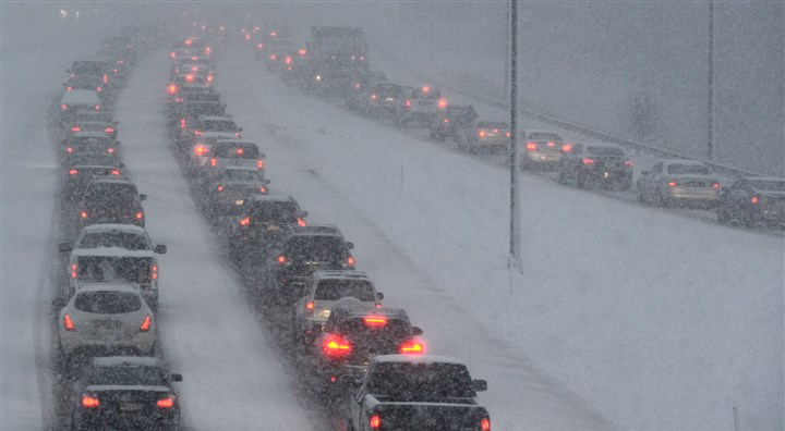 Parkway North snow Traffic moves at a slow pace during a burst of snow this morning on the Parkway North.