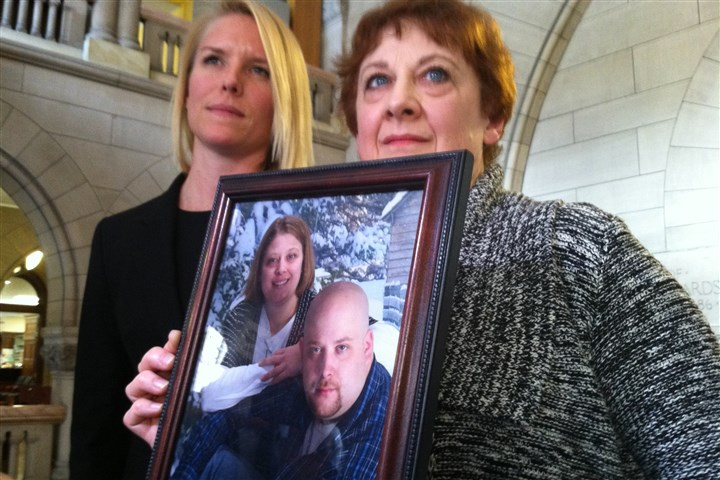 Konias sentencing, family of Michael Haines Ann Haines, right, holds a photo of her slain son Michael Haines (pictured with his sister Betsy Haines) after Kenneth Konias was sentenced Tuesday to life in prison without parole for the killing. Ms. Haines is accompanied by family friend Christina French.