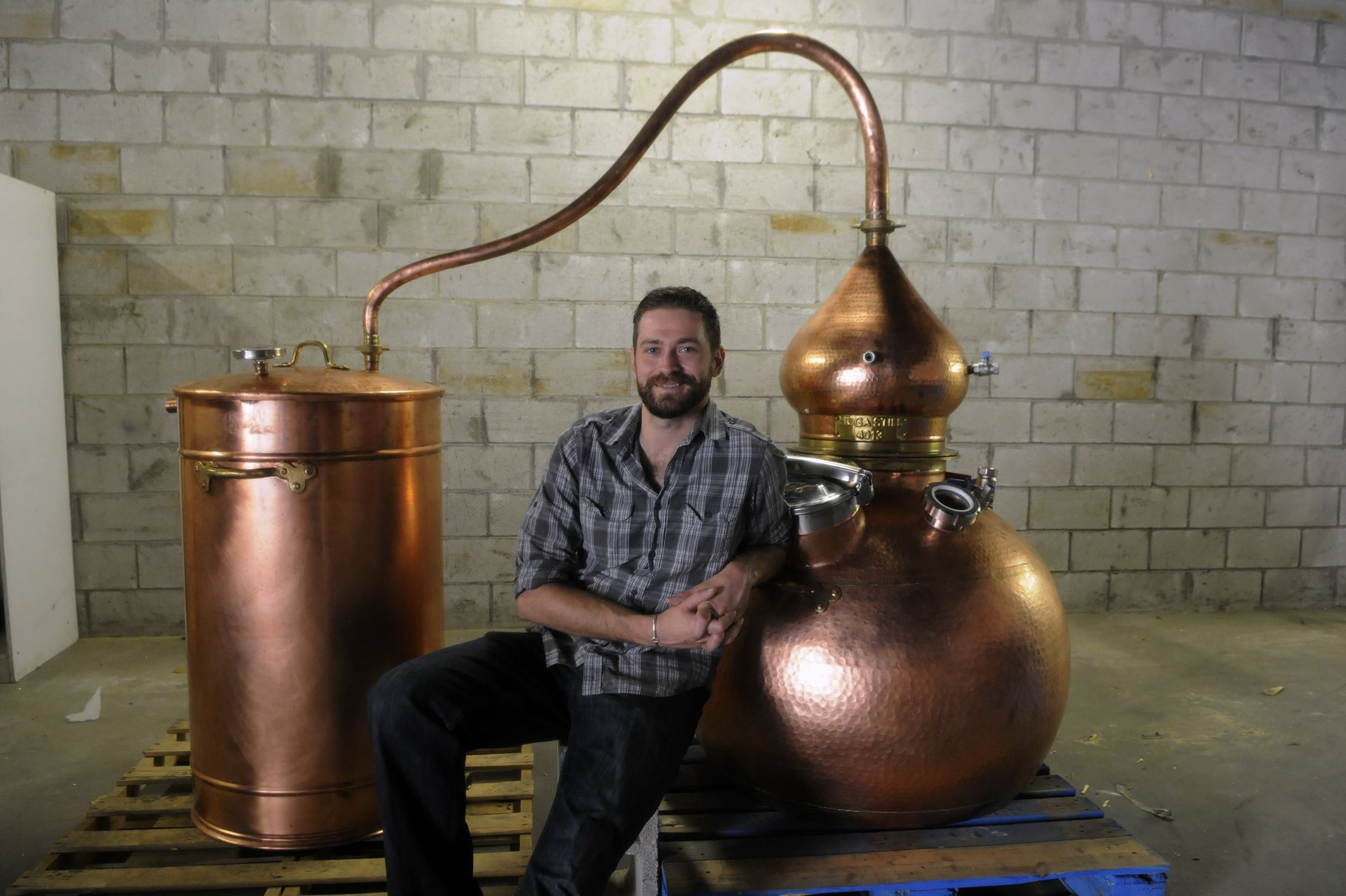 Tim Russell of Maggie's Farm Spirits Tim Russell, owner of Maggie's Farm Spirits in the Strip District, with his Spanish-made copper pot still.