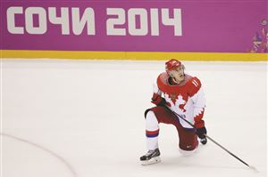 Russia forward Evgeni Malkin looks up at the scoreboard after men's quarterfinal hockey game against Finland in Bolshoy Arena at the 2014 Winter Olympics, Wednesday, Feb. 19, 2014, in Sochi, Russia. Finland defeated Russia 3-1.
