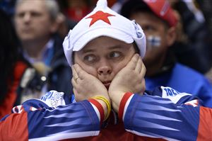 A Russian supporter reacts during the Men's Ice Hockey Play-offs Quarterfinals match between Finland and Russia at the Bolshoy Ice Dome during the Sochi Winter Olympics on February 19, 2014. Finland won 3-1.