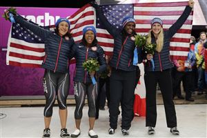 From left to right, silver medal winners from the United States Elana Meyers and Lauryn Williams, and bronze medal winners from the United States Aja Evans and Jamie Greubel pose for pictures after the women's bobsled competition at the 2014 Winter Olympics, Wednesday, Feb. 19, 2014, in Krasnaya Polyana, Russia.