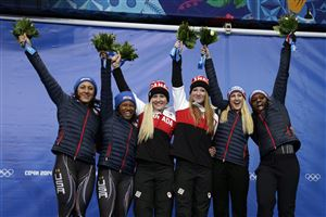 From left to right, silver medal winners from the United States Elana Meyers and Lauryn Williams, gold medal winners from Canada Kaillie Humphries and Heather Moyse, and bronze medal winners from the United States Jamie Greubel and Aja Evans pose during the flower ceremony during the women's bobsled competition at the 2014 Winter Olympics, Wednesday, Feb. 19, 2014, in Krasnaya Polyana, Russia.