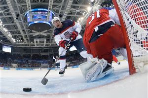 SOCHI, - - FEBRUARY 19: David Backes #42 of the United States scores his team's third goal in the first period against Ondrej Pavelec #31 of the Czech Republic during the Men's Ice Hockey Quarterfinal Playoff on Day 12 of the 2014 Sochi Winter Olympics at Shayba Arena on February 19, 2014 in Sochi, Russia.