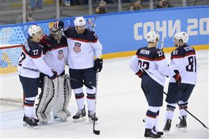 US players celebrate winning the Men's Ice Hockey Quarterfinals match between the USA and the Czech Republic at the Shayba Arena during the Sochi Winter Olympics on February 19, 2014.