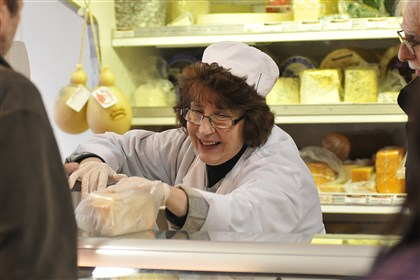 Dearheart 2 Carol Pascuzzi, cheesemonger at Penn Mac since 1984, bags a piece of cheese.