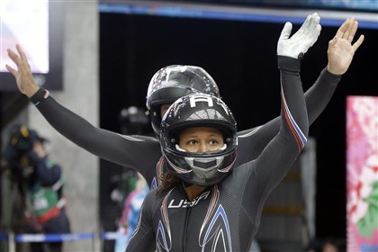 lauryn0219g U.S. brakewoman Lauryn Williams, front, waves to fans after she and pilot Elana Meyers competed their two-man bobsled run Tuesday in Krasnaya Polyana, Russia.