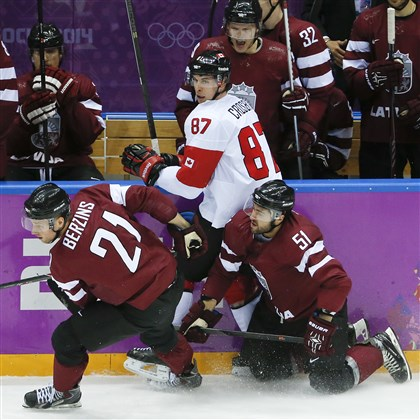sid canada Latvia forward Armands Berzins and forward Koba Jass collide with Canada forward Sidney Crosby during the second period of a men's quarterfinal ice hockey game at the 2014 Winter Olympics, Wednesday, Feb. 19, 2014, in Sochi, Russia.
