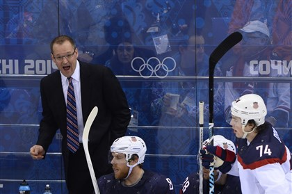 ushockey USA coach Dan Bylsma talks to his players during his team's victory against the Czech Republic at the Sochi Winter Olympics.
