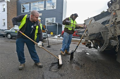 "20140219radPotholePatchingLocal03-2 A Pittsburgh Public Works crew patches potholes on 43rd Street in Pittsburgh's Lawrenceville neighborhood Wednesday afternoon. Mayor Bill Peduto announced ""Pothole Blitz 2,"" a round-the-clock effort to patch potholes after recent bad weather."
