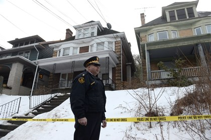 Wolfe sisters death investigation 02 On Feb. 19, police enter 703 Chislett St. in East Liberty while investigating the killing of two sisters that occurred next door.