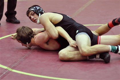 20140217hoBurnhamzsports.jpg Pine-Richland's Brendan Burnham, pinning Upper St. Clair's Brooks Wilding in Chartiers-Houston tournament, is a section title favorite.