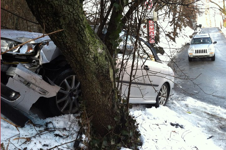 South Side crash A car slid on icy pavement this morning and crashed into a tree along Barry Street at the intersection with Josephine Street on the South Side.